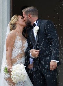 Slovakian tennis player Dominika Cibulkova kisses her husband Michal Navara after their church wedding ceremony at the St Martin's Cathedral in Bratislava on July 9,2016. / AFP PHOTO / SAMUEL KUBANI